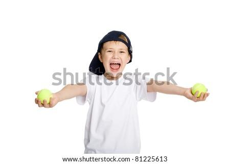 Screaming boy with tennis balls. - stock photo