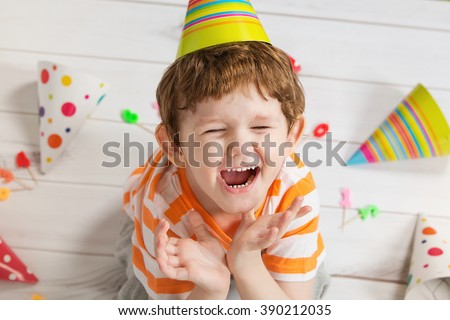 Screaming child in birthday party, cute boy crying. - stock photo