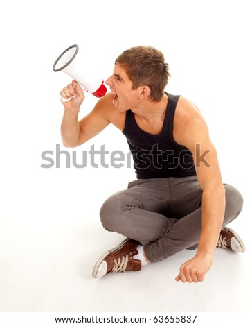 screaming furious young man with megaphone, isolated - stock photo