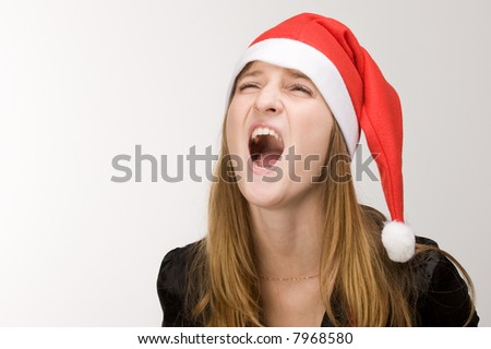 Screaming girl in red santa's hat