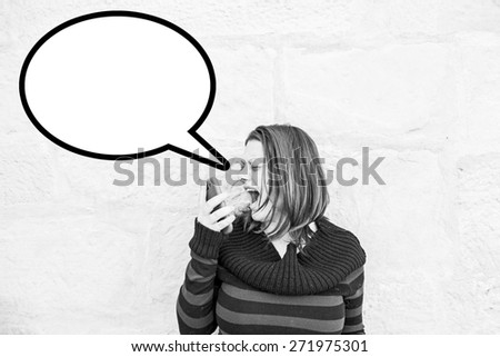 Screaming girl with mobile in urban street, phone - stock photo