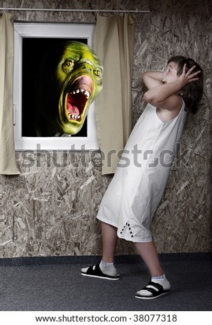 Screaming green zombie and fright little girl - green wooden head is unauthorized homemade work Great for Halloween brochures and advertisements - stock photo