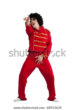 Screaming happy man wearing red costume and black wig over white background - stock photo