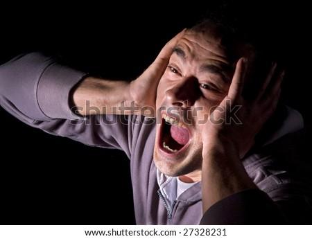 Screaming in despair - stock photo
