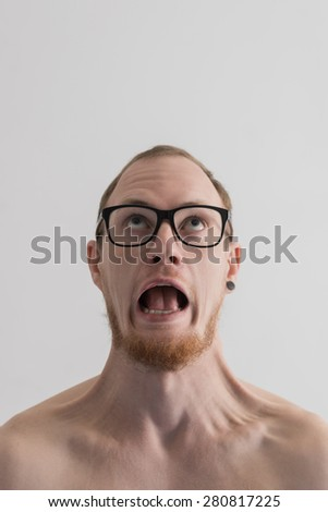 Screaming man portrait against plain background - stock photo