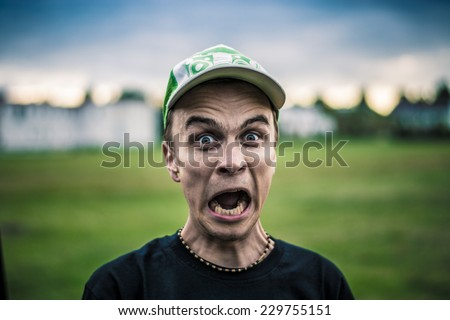 Screaming man portrait, outdoor - stock photo
