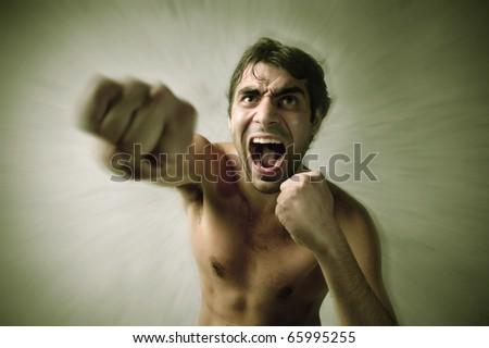 Screaming man punching - stock photo