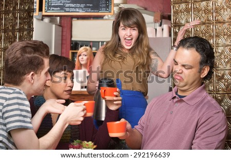 Screaming waitress with picky customers in coffee house - stock photo