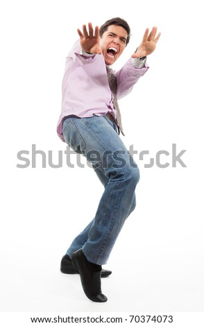 screaming with open mouth and pushes away with his hands, wearing jeans, shirt and tie, isolated on white