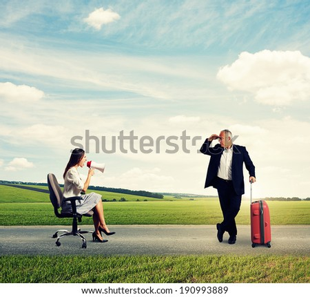 screaming woman and senior man with suitcase on the road