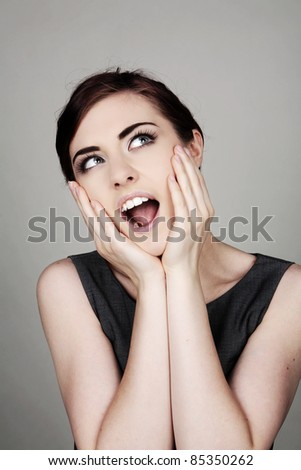 screaming woman with hands up to face - stock photo