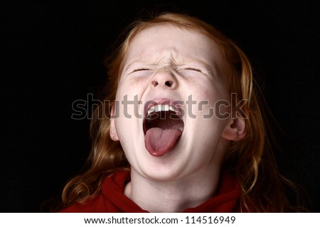 Screaming young girl - stock photo