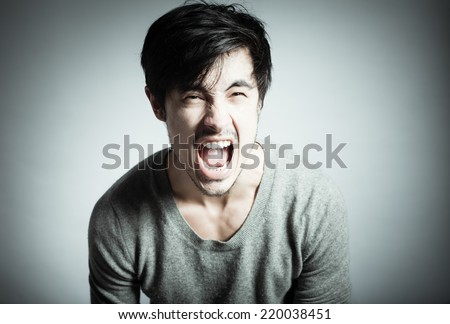 Screaming young men - stock photo