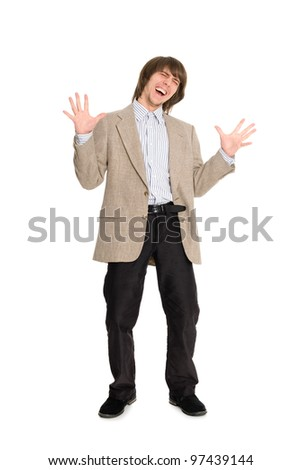 Screaming young woman with outstretched arms to the sides. - stock photo
