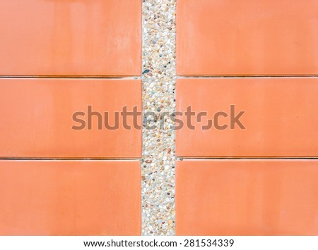 Scree wall with red plate of the countryside house. - stock photo