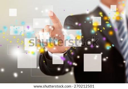 Screen. Businessman holding touchscreen - stock photo