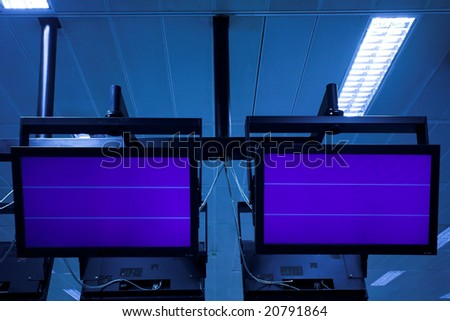 Screen in airport hall - stock photo