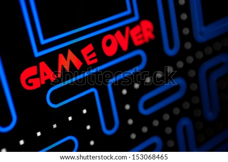 Screen showing that the Game is Over. Macro picture of a video game. - stock photo