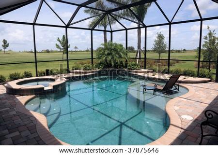 Screened in outdoor luxury swimming pool - stock photo
