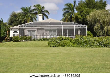 Screened in patio for a home in Naples Florida - stock photo
