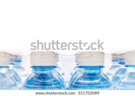Screw cap used to seal  plastic bottles for drinking water in a plastic packaging - stock photo