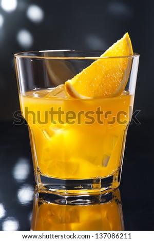 Screw Driver orange cocktail i a disco setting - stock photo
