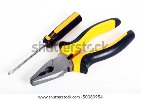 screwdriver and pliers isolated on a white background - stock photo