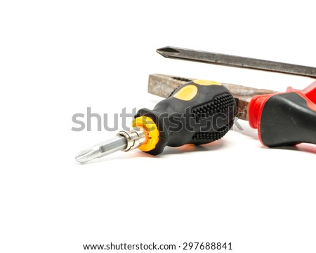 screwdriver and pliers on white background - stock photo