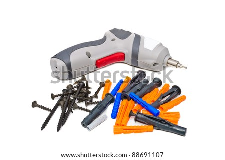 Screwdriver, Screws and plugs. Isolated on a white background