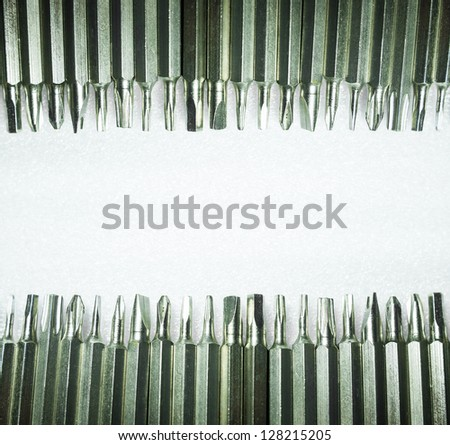 Screwdriver tips arranged to the top and bottom. Able to use as background