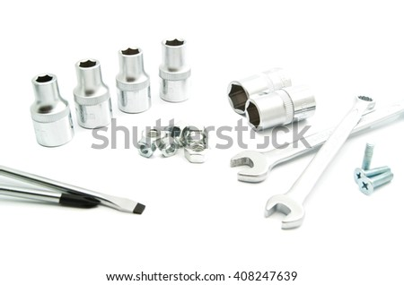 screwdrivers, wrenches, heads and screws on white background