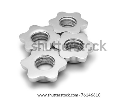 Screws from the dumbbells like the cogwheel isolated on white - stock photo