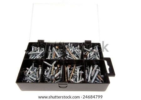 Screws in plastic box on white