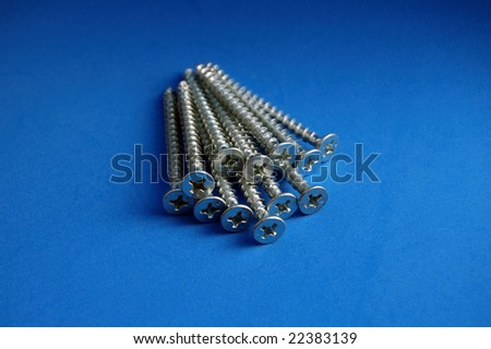 Screws on Blue Background