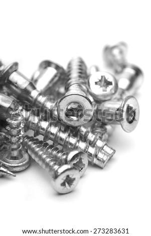 Screws on white background - close-up - stock photo