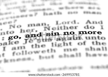 Scripture in New Testament in Bible Go and Sin No More - stock photo