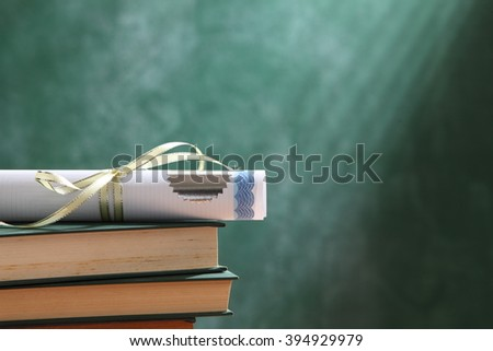 scroll of certificate on top of the book