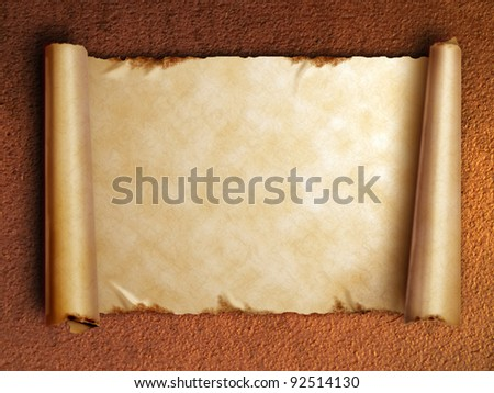 Scroll of old paper with curled edges against the rusty wall - stock photo