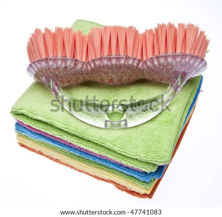 Scrubbing brush with microfiber cloths.  Bright image for spring cleaning!