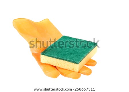 Scrubbing sponge on a yellow rubber glove - isolated - stock photo