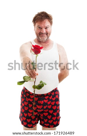 Scruffy looking guy in his underwear handing you a single red rose.  Isolated on white. - stock photo