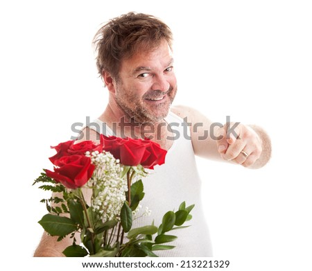 Scruffy looking man in his underwear holding roses and pointing at you.  Isolated on white.   - stock photo