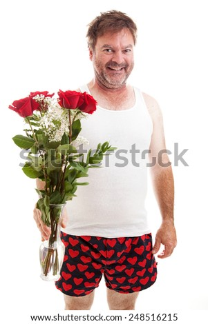 Scruffy looking middle aged guy in his underwear holding a bouquet of red roses for Valentines Day.  Isolated on white.   - stock photo