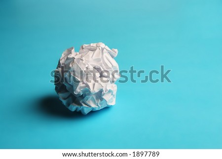 Scrunched paper on a blue background - stock photo