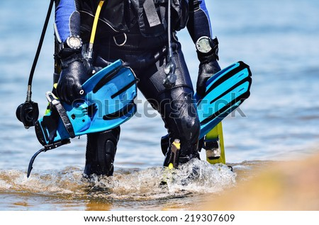 Scuba diver after the dive is beached - stock photo