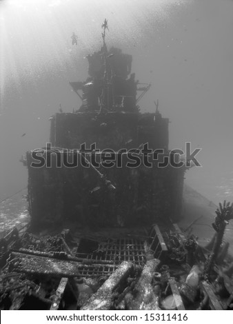 Scuba Diver descends on a Sunken Ship in Black and White