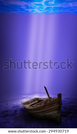 Scuba diver exploring a sunken underwater shipwreck - stock photo