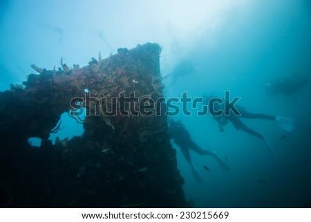 Scuba diver exploring world war II shipwreck in Coron area, Palawan, Philippines. - stock photo