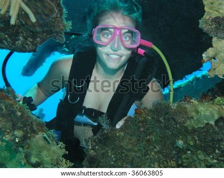 scuba diver female on ship wreck site - stock photo