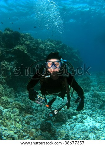 Scuba Diver looking into the Camera in Kona Hawaii - stock photo